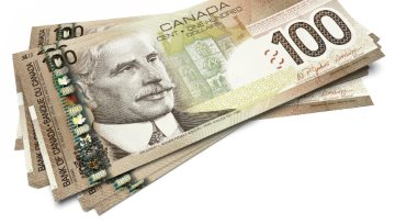 Bank of Canada Keeps Rates on Hold, Canadian Dollar Falls Sharply