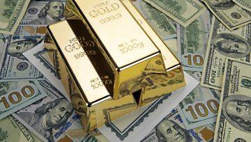 El precio del oro continúa escalando apoyado por la debilidad del dólar estadounidense