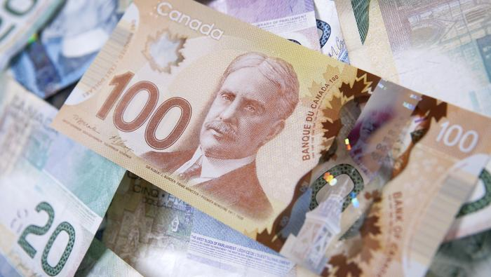 USD/CAD Snaps Lower, Canadian Dollar Soars as BoC Tapers Policy