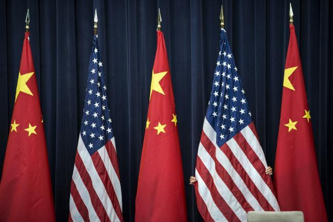 US China flags after US bans five Chinese computing companies