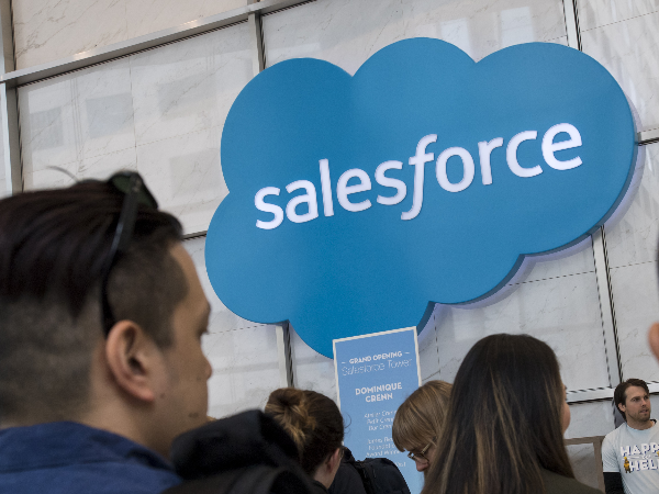 People looking at Salesforce logo after Tableau purchase