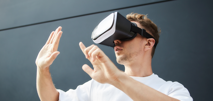 Man wearing a virtual reality headset with Decentraland, a top ethereum dapp