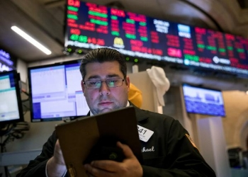 Man looking at stock market