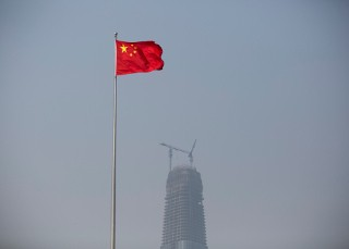 A Chinese flag flies at Spring City Square in Jinan